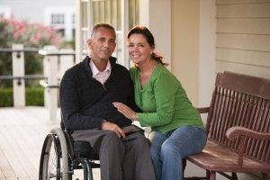 Portrait of a happy couple with him in a wheelchair