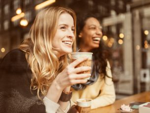 Girlfriends sharing a laugh in Coffeeshop